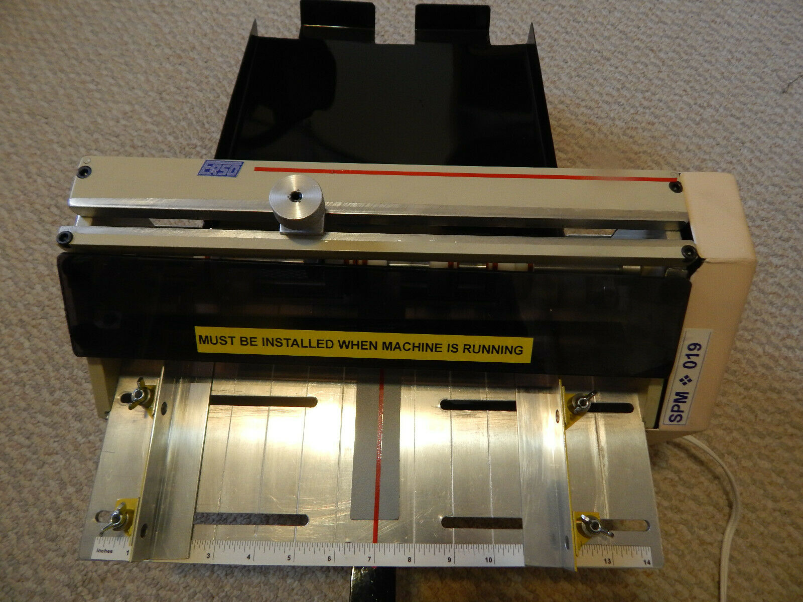 Scoring and perforating machine